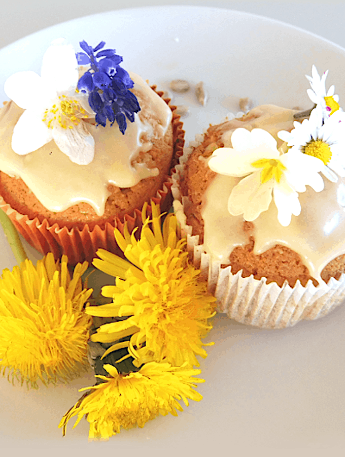 Dandelion cupcakes with white frosting and sunflower seeds