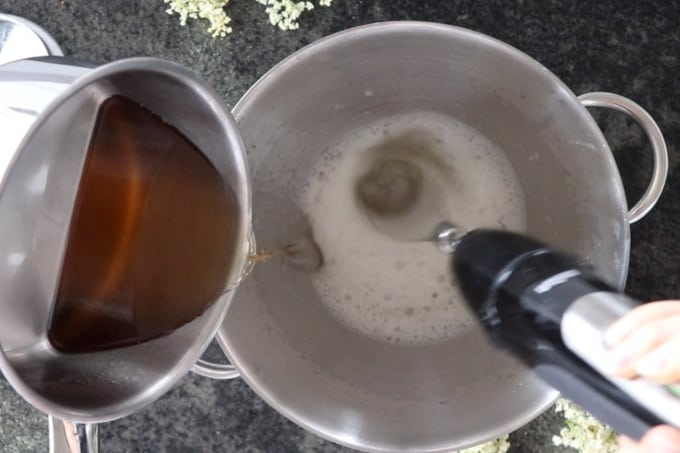 pouring  the syrup into the bowl with the gelatin