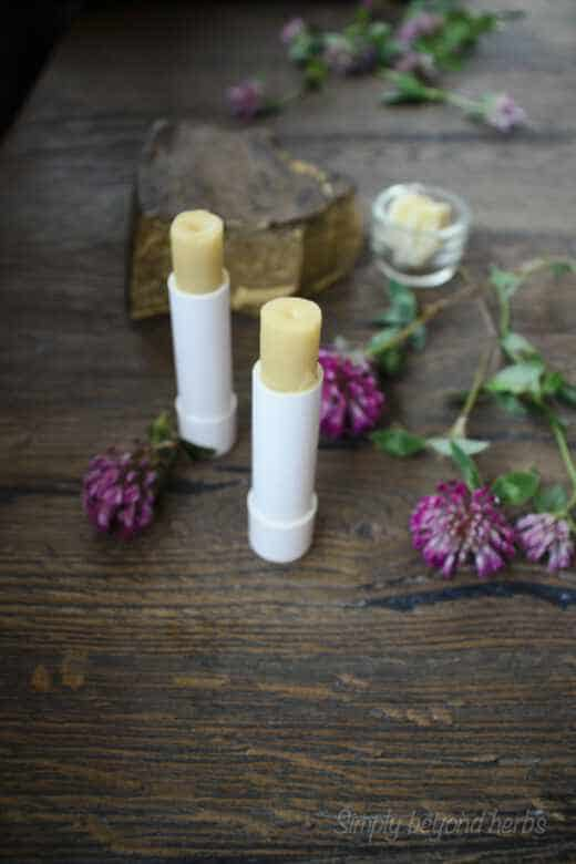 two tubes of DIY lip balms with shea butter and beeswax