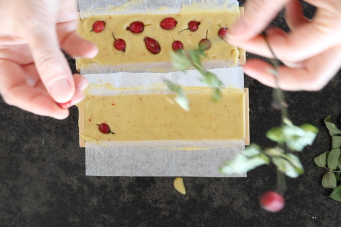 adding rosehips on the top of soap mixture
