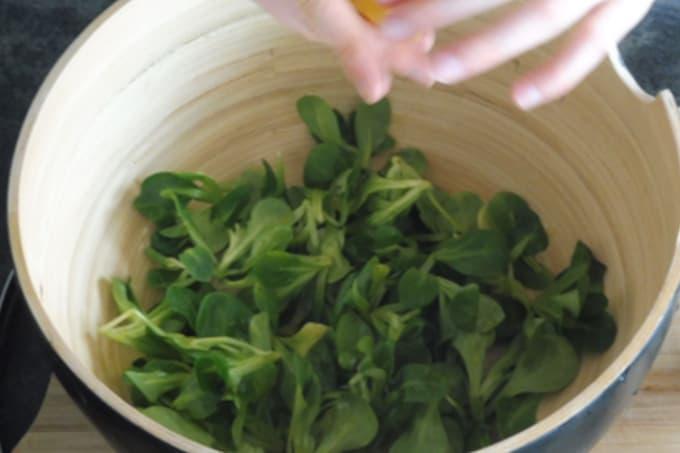preparing salad for naked pizza