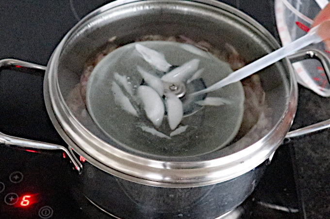 sucking water from cold lid with pipette