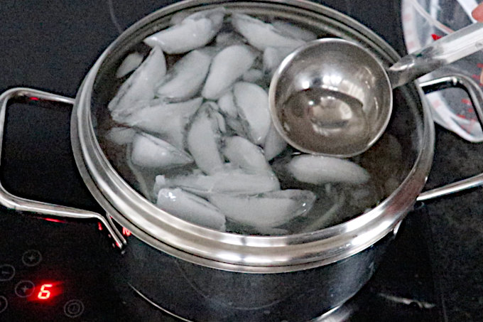 removing melted ice from the lid