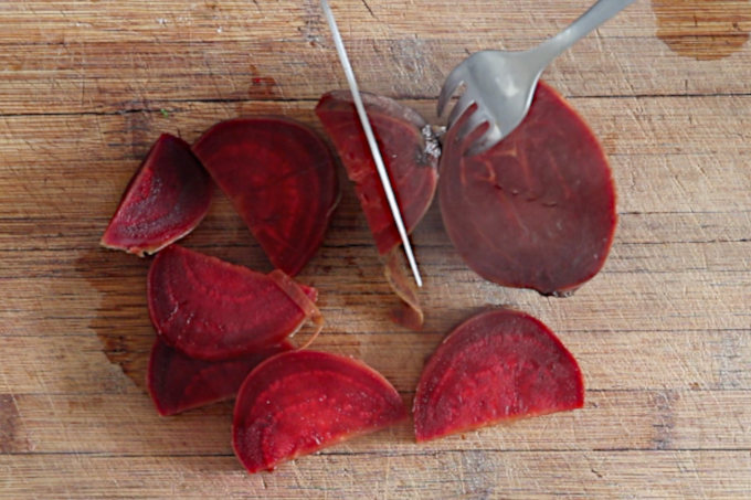 cutting cooked beets into slices