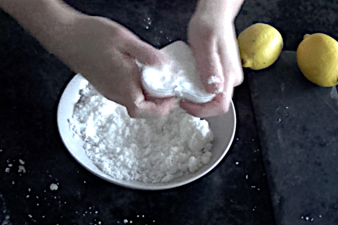 filling the mold with bath bomb mixture